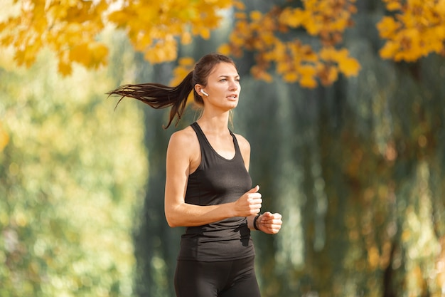 Portrait of sporty woman running