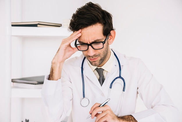 Portrait of a stressed male doctor