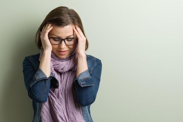 Portrait stressed sad middle aged woman