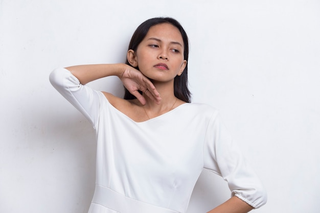 Portrait of stressed sick asian beautiful woman with headache on white background
