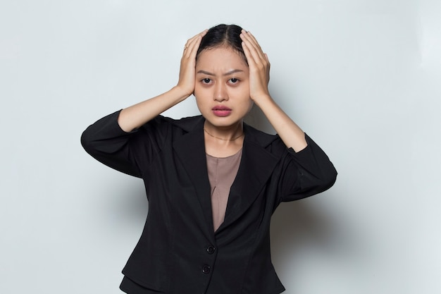 Portrait of stressed sick asian business woman with headache