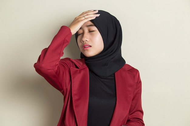Portrait of stressed sick muslim woman with headache ill woman suffers from vertigo, dizziness, migraine, hangover, health care concept young adult asian woman model