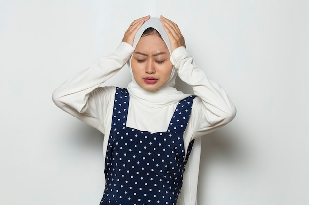 Portrait of stressed sick muslim woman with headache ill woman suffers from vertigo dizziness