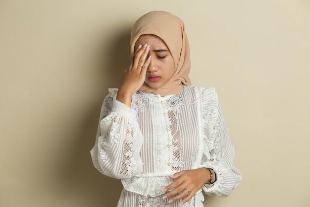Portrait of stressed sick muslim woman with headache ill woman suffers from vertigo