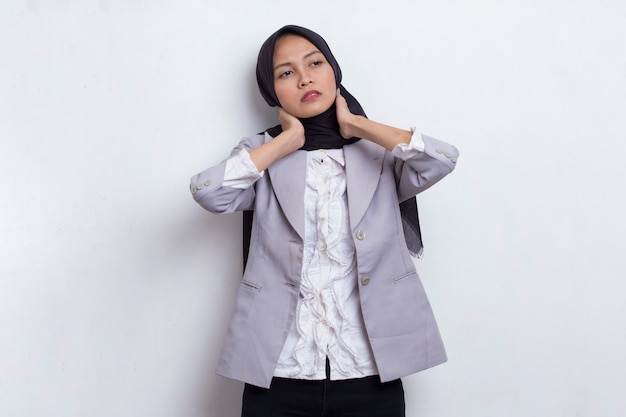 Portrait of stressed tired sick asian muslim woman with headache on white background