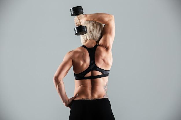 Portrait of a strong muscular sportswoman