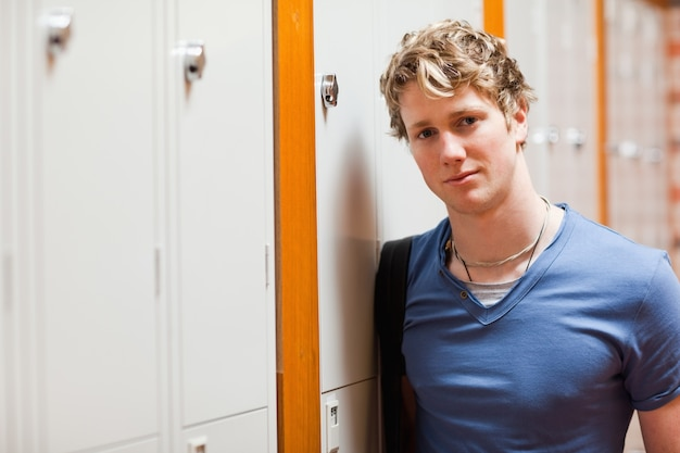 Portrait of a student leaning on a locker