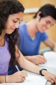 Portrait of students writing