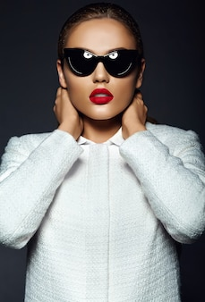 Portrait of stylish beautiful young woman with sunglasses