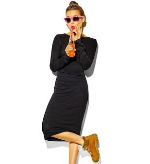 Portrait of stylish beautiful young woman with sunglasses