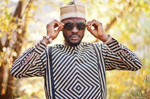 Portrait of stylish man at hat and sunglasses.