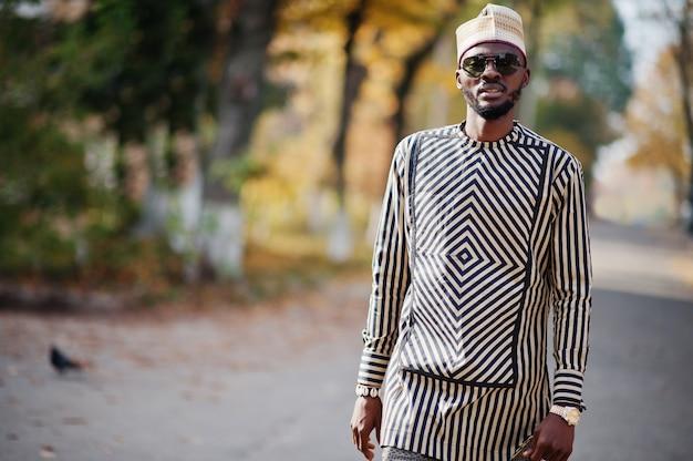 Portrait of stylish man at hat and sunglasses