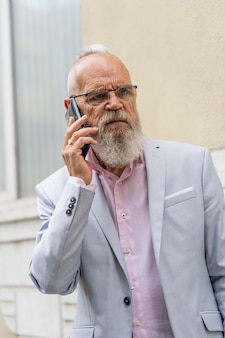 Portrait of stylish senior man speaking on the phone