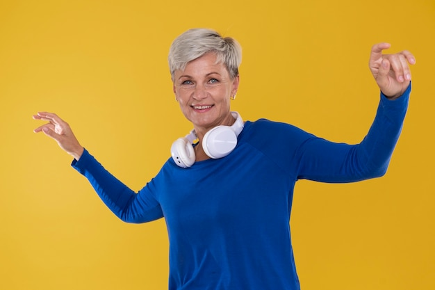 Portrait of stylish senior woman with a pair of headphones