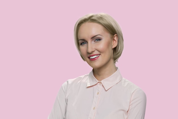 Portrait of successful blonde woman. smiling businesswiman isolated on pink background.