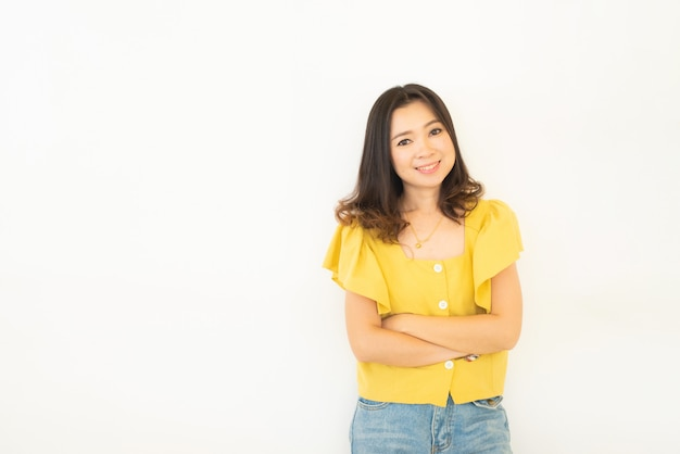 Portrait of successful business asian women in yellow dress with arms crossed and smile