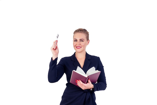 Portrait of successful business woman glasses blonde hairstyle perfect make-up red lips in stylish black suit writing in notebook, notes and pointing finger up studio white isolate. inspiration idea