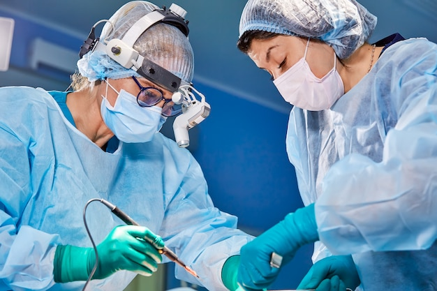 Portrait of a surgeon close-up. surgeons operate on a patient. tense, serious faces. real operation. tensioned atmosphere in the operating room.