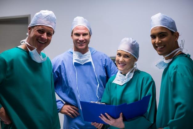 Portrait of surgeons team standing in corridor