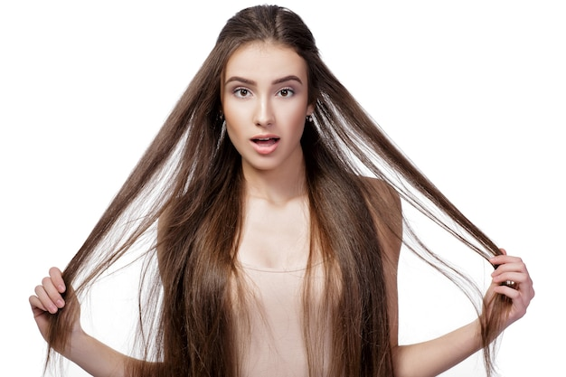 Portrait of surprised beautiful woman with long hair isolated on white background.
