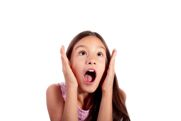 Portrait of surprised, excited, shocked teenage girl looking up isolated on white