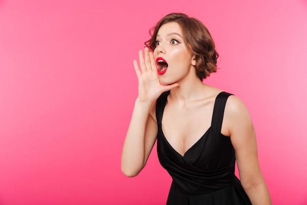 Portrait of a surprised girl dressed in black dress