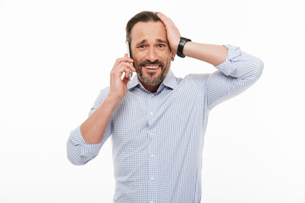 Portrait of a surprised mature man dressed in shirt