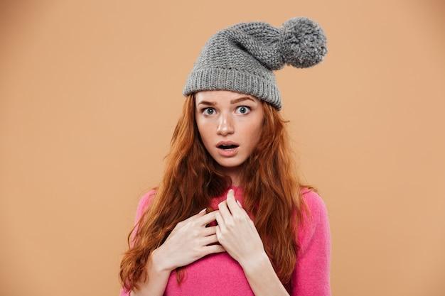 Portrait of a surprised pretty redhead girl