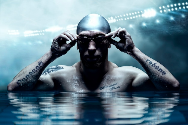 Portrait of a swimmer on the background of a sports arena.