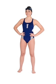 Portrait of swimmer in blue swimsuit with goggle and swimming hat against white background. sport concept.