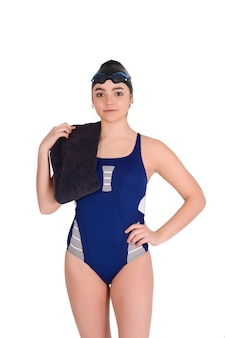 Portrait of swimmer in blue swimsuit with goggle and swimming hat against white space