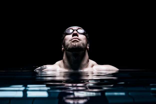 Portrait of a swimmer. the concept of swimming and water games