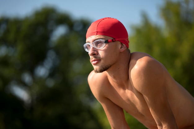 Portrait of swimmer in nature