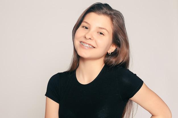 Portrait of teen girl showing dental braces