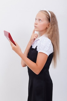 Portrait of teen girl with calculator on white