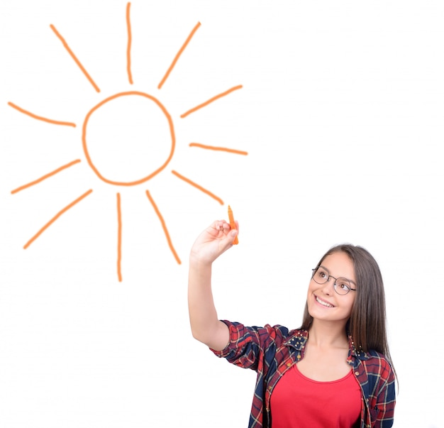 Portrait of a teenage girl, drawing the sun in space.