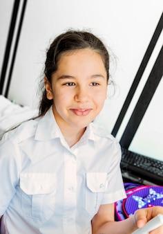 Portrait of a teenage girl in a school uniform