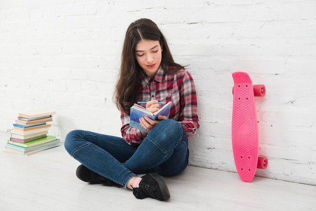 Portrait of teenage girl with book