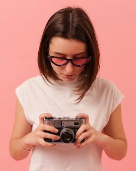 Portrait teenage girl with camera