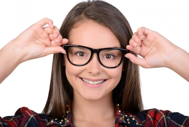 Portrait of teenage girl with glasses.