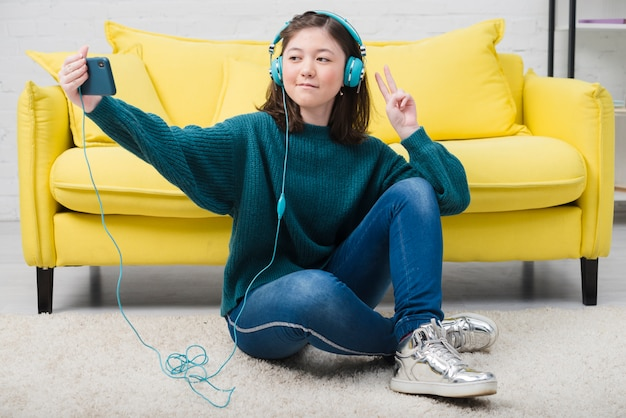Portrait of teenage girl with music concept