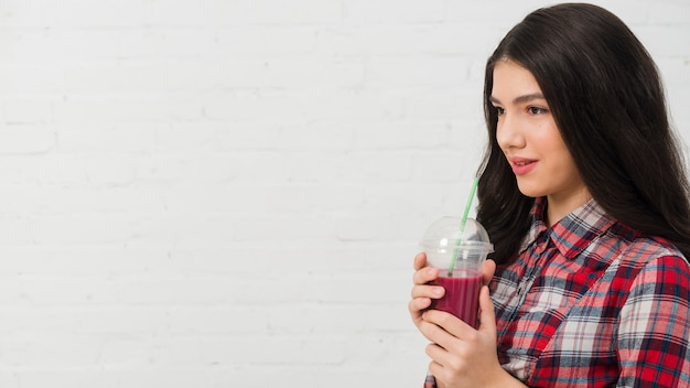 Portrait of teenage girl with smoothie