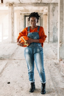 Portrait of teenager posing with basketball ball
