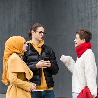 Portrait of teenagers talking to each other
