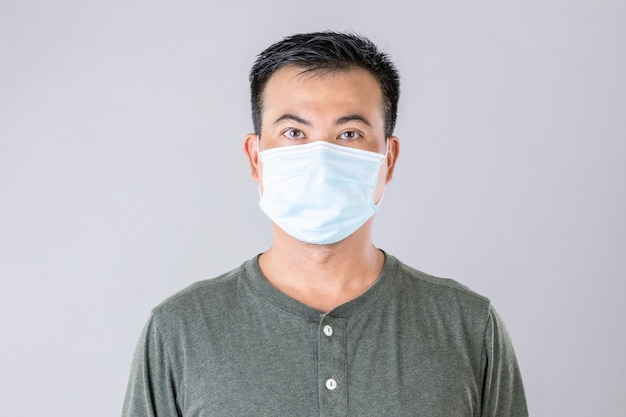Portrait of thai man wearing protective face mask to prevent virus