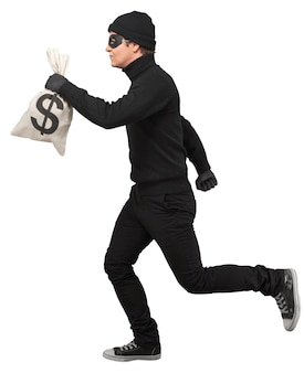 Portrait of a thief running with money bag