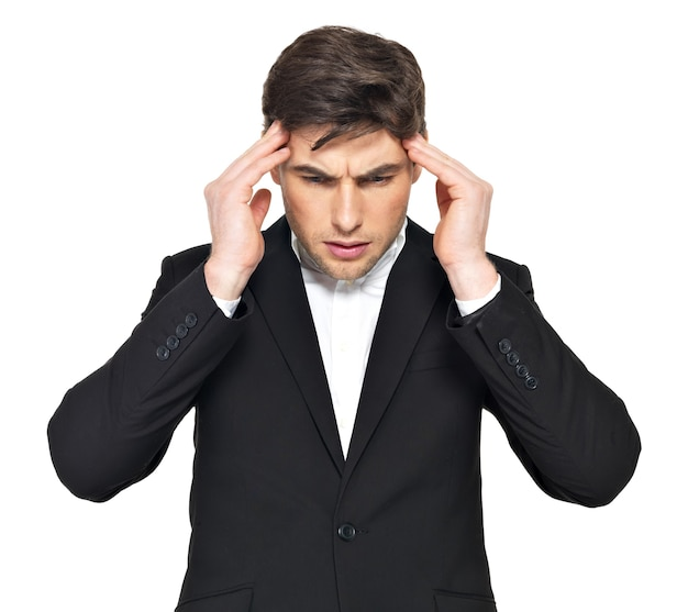 Portrait of the thinking businessman with hands at head. portrait of a young man who is under heavy stress