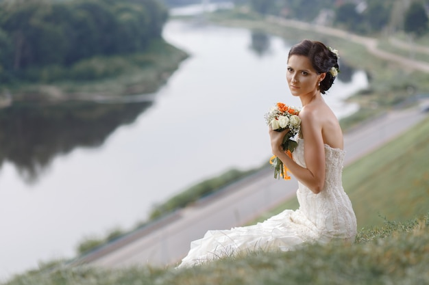 Portrait of thoughtful young bride