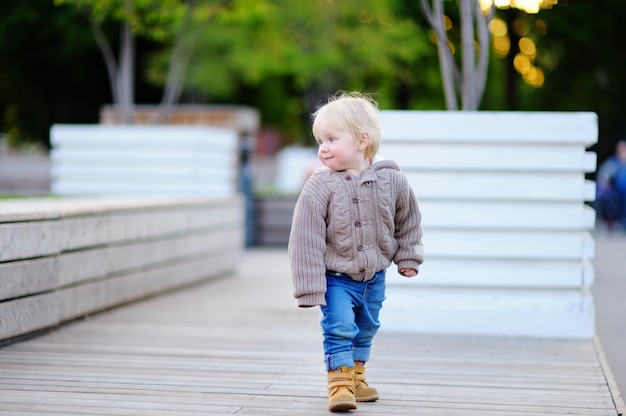 Portrait of toddler boy walking in a big city