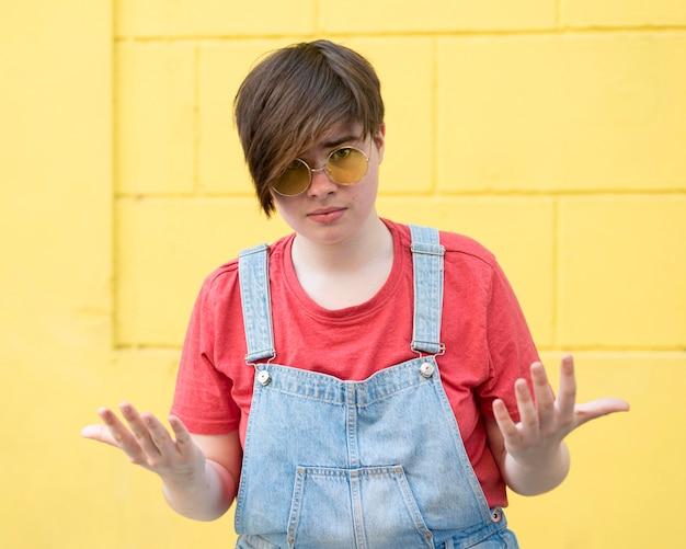 Portrait of trendy teenager posing